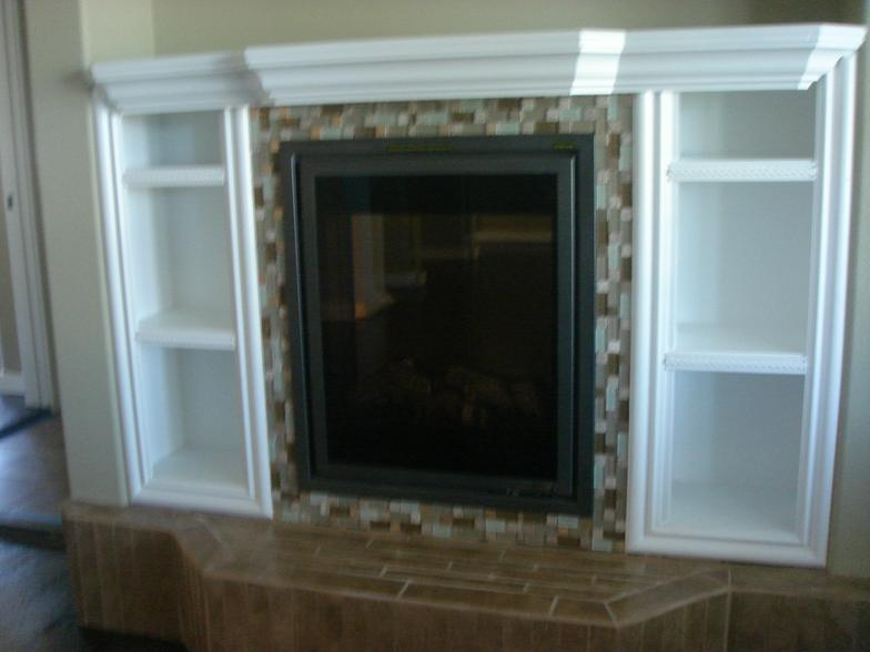 Space beside a fireplace can be used to store movies or display items.