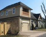 A new garage and 2nd story master suite greatly expanded this home's living space.
